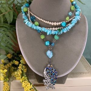 Adorned Crown assemblage teal 4 strand necklace